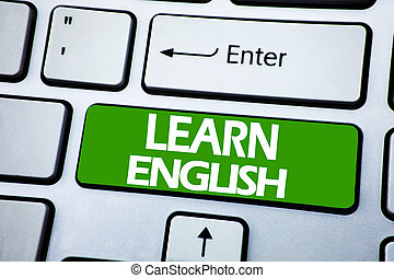 Handwriting Announcement text showing Learn English. Business concept for Language School written on blue key on the keybord background.