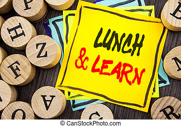 Handwriting Announcement text showing Lunch And Learn. Business photo showcasing Presentation Training Board Course written on wooden abckground with letters