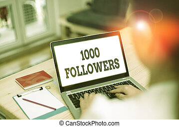 Handwriting text 1000 Followers. Concept meaning number of individuals who follows someone in Instagram.