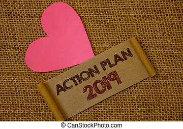 Handwriting text Action Plan 2019. Concept meaning Challenge Ideas Goals for New Year Motivation to Start Ideas on old vintage paper black red letters wicker background pink heart.