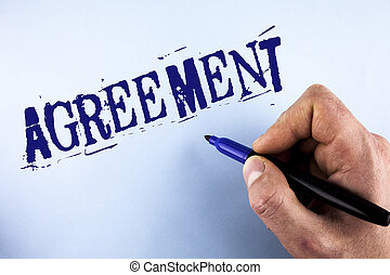 Handwriting text Agreement. Concept meaning Business or personal closures made easy with better guidance written by Man on plain background holding Marker in Hand.