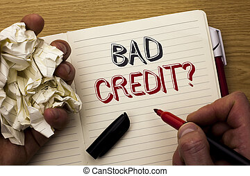 Handwriting text Bad Credit Question. Concept meaning Low...