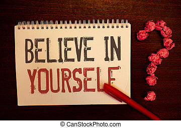 Handwriting text Believe In Yourself. Concept meaning Determination Positivity Courage Trust Faith Belief Reddish paper balls structures question mark red pen notebook browny desk.