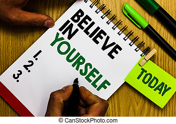 Handwriting text Believe In Yourself. Concept meaning Encouraging someone Self-confidence Motivation quote Diary pen notepad ring pen marker pointer script daily work handwriting.
