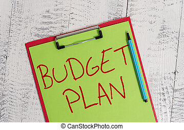 Handwriting text Budget Plan. Concept meaning financial schedule for a defined period of time usually year Colored clipboard blank paper sheet marker old wooden vintage background.