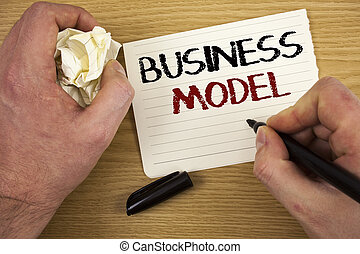 Handwriting text Business Model. Concept meaning Innovative Strategic Plan Marketing Vision Successful Ideas Text two words white paper note black marker hand crumbled paper note.