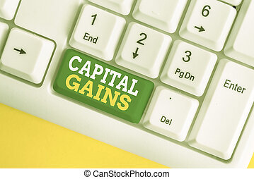 Handwriting text Capital Gains. Concept meaning Bonds Shares Stocks Profit Income Tax Investment Funds White pc keyboard with empty note paper above white background key copy space.