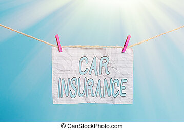Handwriting text Car Insurance. Conceptual photo Accidents coverage Comprehensive Policy Motor Vehicle Guaranty Clothesline clothespin rectangle shaped paper reminder white wood desk