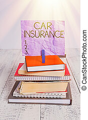 Handwriting text Car Insurance. Conceptual photo Accidents coverage Comprehensive Policy Motor Vehicle Guaranty pile stacked books notebook pin clothespin colored reminder white wooden