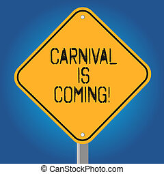 Handwriting text Carnival Is Coming. Concept meaning public festival which showing play music and dance Blank Diamond Shape Color Road Warning Signage with One Leg Stand photo.
