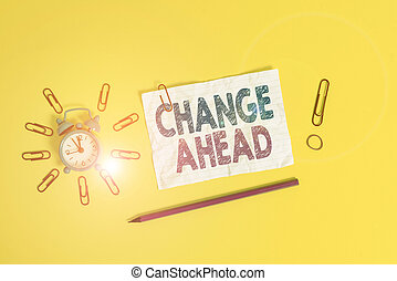 Handwriting text Change Ahead. Concept meaning to replace with or exchange for another Become different Metal alarm clock clips crushed sheet pencil rubber band colored background.