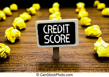 Handwriting text Credit Score. Concept meaning Represent the creditworthiness of an individual Lenders rating Blackboard crumpled papers several tries mistake not satisfied wooden floor.