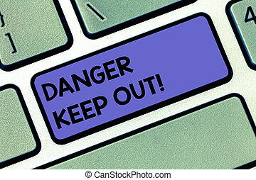 Handwriting text Danger Keep Out. Concept meaning Warning be alert stay away from this point safety sign Keyboard key Intention to create computer message pressing keypad idea.