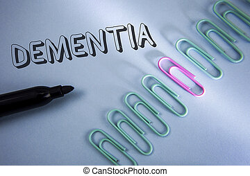 Handwriting text Dementia. Concept meaning Long term memory loss sign and symptoms made me retire sooner written on Plain Blue background Paper Clips and Marker next to it.