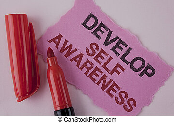 Handwriting text Develop Self Awareness. Concept meaning improve your Informations about surrounding events written on Tear Pink Sticky note paper on the plain background Marker next to it.