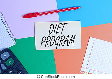 Handwriting text Diet Program. Concept meaning practice of eating food in a regulated and supervised fashion Office appliance colorful square desk study supplies empty paper sticker.