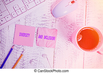 Handwriting text Diversity And Inclusion. Concept meaning range difference includes race ethnicity gender technological devices colored reminder paper office supplies keyboard mouse.