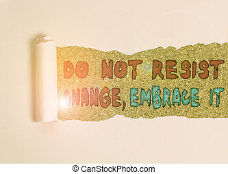 Handwriting text Do Not Resist Change Embrace It. Concept meaning Be open to changes try new things Positive Cardboard which is torn in the middle placed above a wooden classic table.