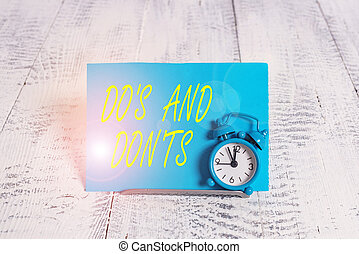 Handwriting text Dos And Don tS. Concept meaning Rules or ...