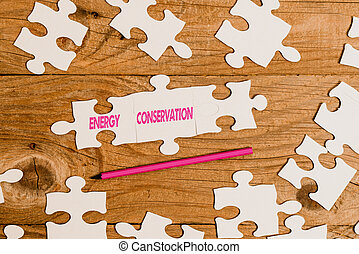 Handwriting text Energy Conservation. Business showcase Reduction in the amount of energy consumed in a process Building An Unfinished White Jigsaw Pattern Puzzle With Missing Last Piece