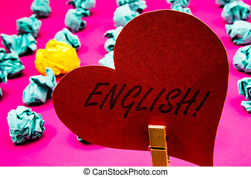Handwriting text English Motivational Call. Concept meaning Relating to England its People or their Language Clothespin holding red heart paper crumpled papers ideas mistakes trials.