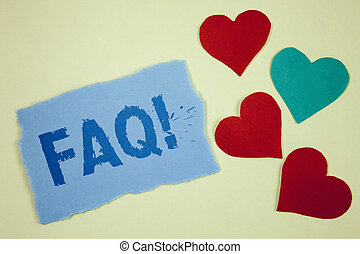 Handwriting text Faq Motivational Call. Concept meaning Frequently asked question for clearing up confusions written on Tear sticky note paper piece on plain background paper Hearts next to it.