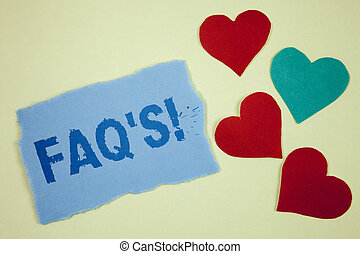 Handwriting text Faq'S Motivational Call. Concept meaning Multiple questions answered for online product written on Tear sticky note paper piece on plain background paper Hearts next to it.