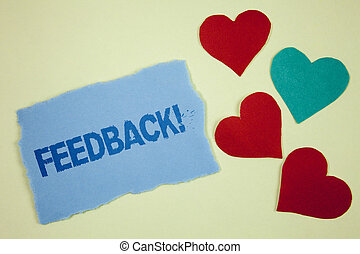 Handwriting text Feedback Motivational Call. Concept meaning Rating an economical local grocery store written on Tear sticky note paper piece on plain background paper Hearts next to it.