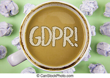Handwriting text Gdpr Motivational Call. Concept meaning General Data Protection Regulation Information Safety written on Tea in white Cup within Crumpled Paper Balls on plain Green background.