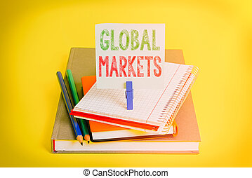 Handwriting text Global Markets. Concept meaning Trading goods and services in all the countries of the world Book pencil rectangle shaped reminder notebook clothespin office supplies.