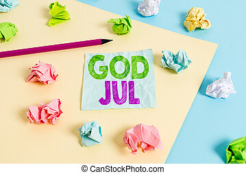 Handwriting text God Jul. Concept meaning Merry Christmas Greeting showing for new year happy holidays Colored crumpled papers empty reminder blue yellow background clothespin.