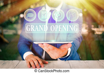 Handwriting text Grand Opening. Concept meaning Ribbon Cutting New Business First Official Day Launching.
