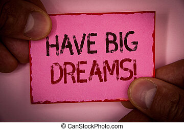 Handwriting text Have Big Dreams Motivational Call. Concept meaning Future Ambition Desire Motivation Goal Words written pink paper note red border fingers holding corners message.