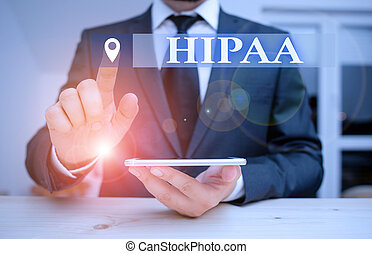 Handwriting text Hipaa. Conceptual photo Acronym stands for Health Insurance Portability Accountability Male human wear formal clothes present presentation use hi tech smartphone