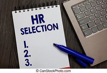 Handwriting text Hr Selection. Concept meaning Process and approached by human resources when hiring employees Open notebook white page black marker computer keyboard wooden background.