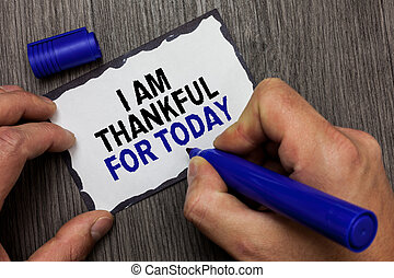 Handwriting text I Am Thankful For Today. Concept meaning Grateful about living one more day Philosophy Gray wooden deck hand hold black marker written black lined sticky note.