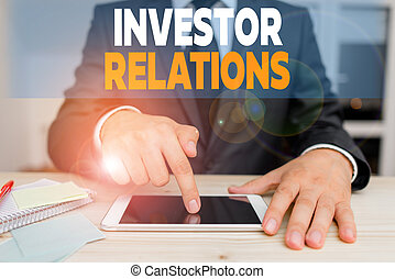 Handwriting text Investor Relations. Concept meaning ...