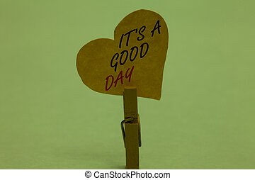 Handwriting text It s is A Good Day. Concept meaning Happy time great vibes perfect to enjoy life beautiful Celadon color background paper clip hold love heart for loving with words.