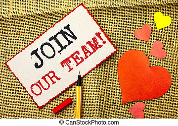 Handwriting text Join Our Team Motivational Call. Concept meaning Invitation to Work Together Job Offer written on Sticky Note Paper by Pointer on the jute background Love Hearts next to it.