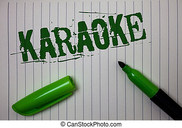 Handwriting text Karaoke. Concept meaning Entertainment singing along instrumental music played by a machine Linned paper background pen cap marker highlighter ink green drawing.