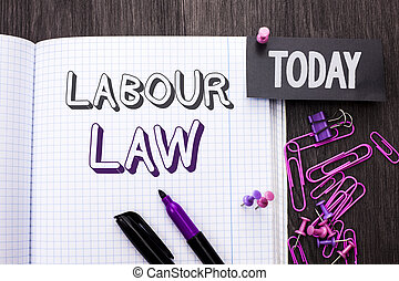 Handwriting text Labour Law. Concept meaning Employment Rules Worker Rights Obligations Legislation Union written on Notebook Book on wooden background Today with Thumbpin Marker Paper Clip.