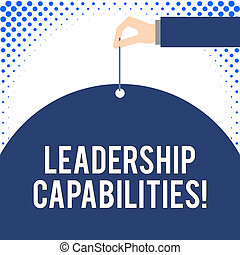 Handwriting text Leadership Capabilities. Concept meaning Set of Perforanalysisce Expectations a Leader Competency Male hand arm needle punching big half blank balloon geometrical background.