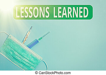 Handwriting text Lessons Learned. Concept meaning the knowledge or understanding gained by experience Primary medical precautionary equipments for health care protection.