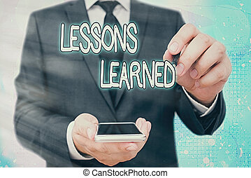 Handwriting text Lessons Learned. Concept meaning the ...
