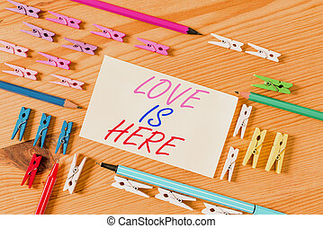 Handwriting text Love Is Here. Concept meaning Roanalysistic...