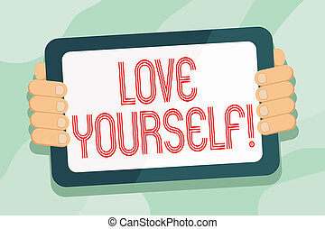 Handwriting text Love Yourself. Concept meaning have self respect positive image and unconditional acceptance Color Tablet Smartphone with Blank Screen Handheld from the Back of Gadget.