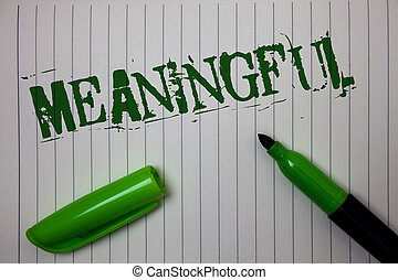 Handwriting text Meaningful. Concept meaning Having meaning Significant Relevant Important Purposeful Linned paper background pen cap marker highlighter ink green drawing.