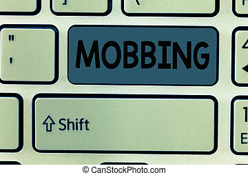 Handwriting text Mobbing. Concept meaning Bulling of individual specially at work Emotional abuse Stress