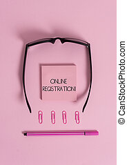 Handwriting text Online Registration. Concept meaning Process to Subscribe to Join an event club via Internet Colored blank sticky note clips binders eyeglasses pen trendy background.