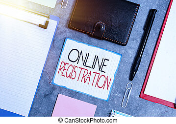 Handwriting text Online Registration. Conceptual photo System for subscribing or registering via the Internet Paper accesories with digital smartphone arranged on different background
